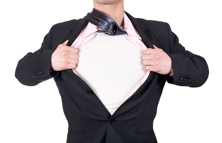 superman: man acting like a super hero and opening his shirt off isolated on white background
