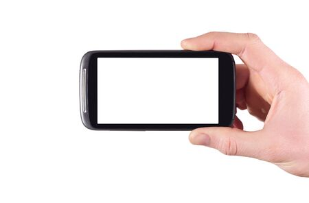 hand holding blank mobile smartphone with clipping path for the screen isolated on white background photo