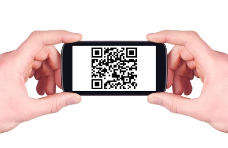 Scanning QR code with smart phone isolated on white background