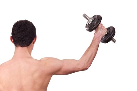 Rear view of a young man doing shoulder exercise with dumbbell isolated on white background