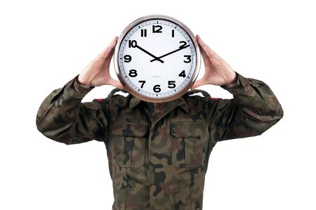 soldier with analog clock over his face. Deadline concept isolated on white background.