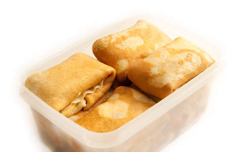 filling in: Pancakes with filling in plastic box at 15Mps horizontal