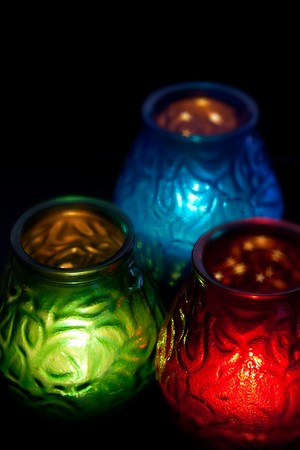 Red, green and blue candle vertical on black at 10Mps photo