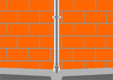 drains: Part of the downspout with a groove and a brick wall.