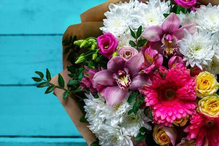 A bouquet of flowers close-up. Alstroemeria, Gerbera, Eustoma, Rose. A festive bouquet.