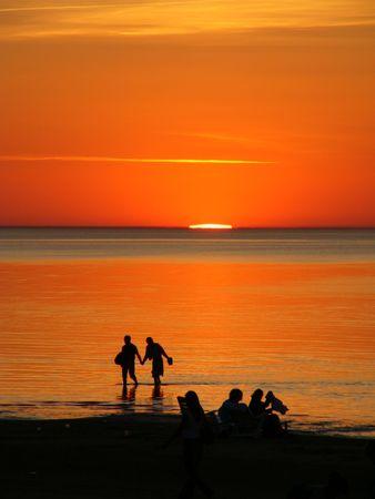 latvia: Jurmala, Latvia, summer, silhouettes of people, sunset of a sun on a sea Stock Photo