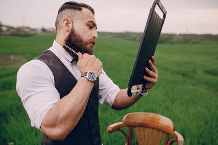 lonley: beard man in field lonley green glass Stock Photo