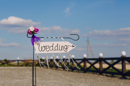 blu sky: arrow labeled wedding on a blu sky