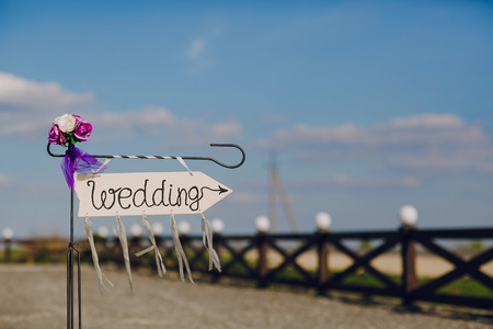 labeled: arrow labeled wedding on a blu sky