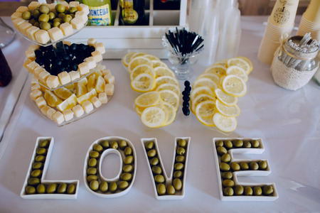 food on white: wedding reception decor food white and viollet Stock Photo