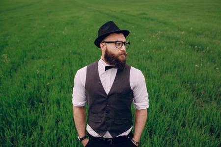 lonley: beard man in field lonley on summer day