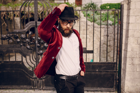 millonario: refined bearded man who looks like a millionaire