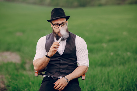 bearded man vaping 스톡 콘텐츠