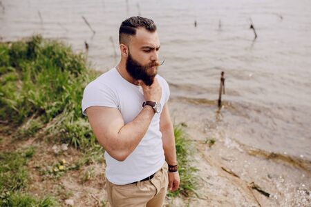 color hair: bearded man on the beach on summer day Stock Photo