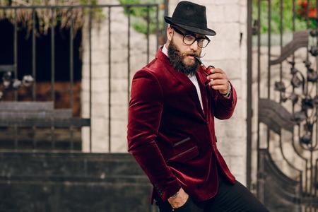 refined bearded man who looks like a millionaire