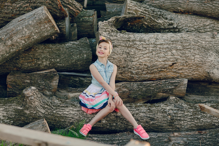 wooden beams: nice little model posing on a background of wooden beams