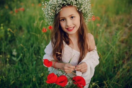 sensual girl: beautiful little girl in a wreath of poppies Stock Photo