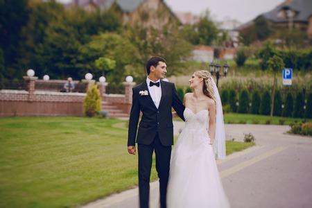 wedding couple: lovely wedding couple walking on their wedding day