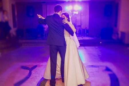 romantic couple dancing on their wedding HD Фото со стока