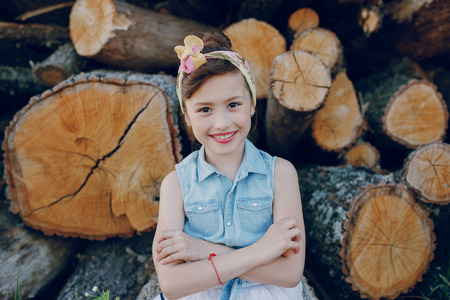 forest wood: nice little model posing on a background of wooden beams