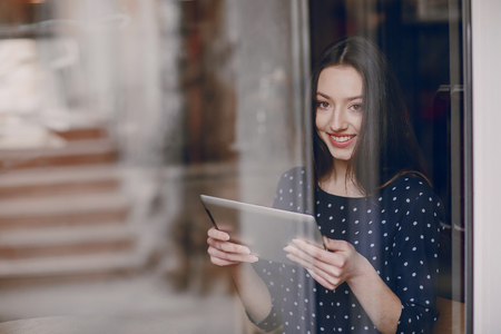 i pad: beautiful young girl enjoys phone and tablet