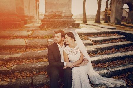 Happy couple whose wedding photo shoot in a golden autumn Stock Photo