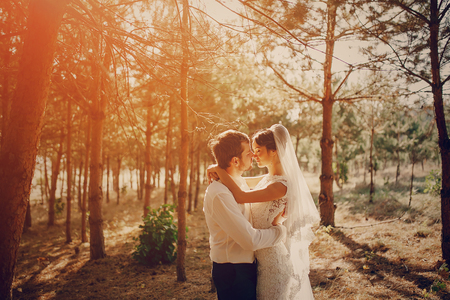 Happy couple whose wedding photo shoot in a golden autumn Stock Photo