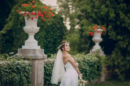 bride dress: charming wedding in the old castle architecture Poland nature and the sun