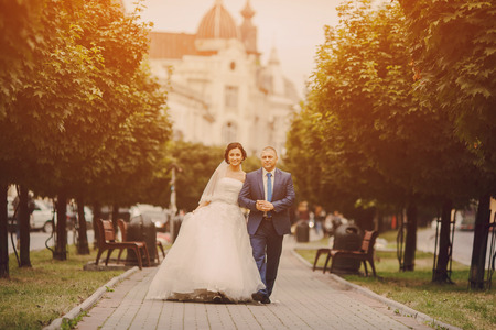 first love: beautiful young couple in wedding sunny summer day