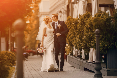 bride: lovely blond summer wedding couple in sunny weather