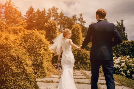 lovely blond summer wedding couple in sunny weather