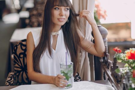 sunni: butifull girl drinks mojito outside  sunni weather