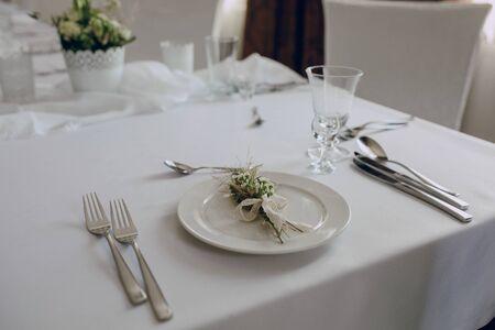 fork glasses: Wedding table setting white plate and fork glasses Stock Photo