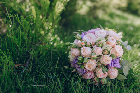 beautiful wedding bouquet on a sunny day lying on the grass