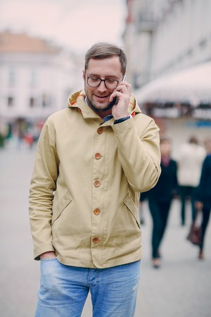 speaks: adult man speaks on the phone and writing text Stock Photo