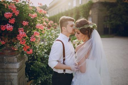 ragazza innamorata: charming wedding in the old castle architecture Poland nature and the sun