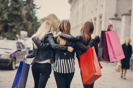 woman with returns from shopping with colored bags fashion Standard-Bild