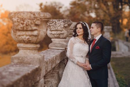 beautiful dress: beautiful wedding couple celebrating their wedding day in autumn