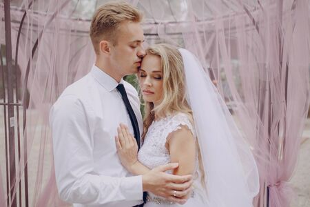relationship love: beautiful blonde couple celebrate their wedding day Stock Photo