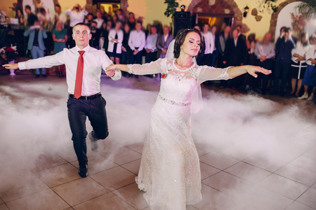first wedding dance of a young couple in the restaurant Stock Photo