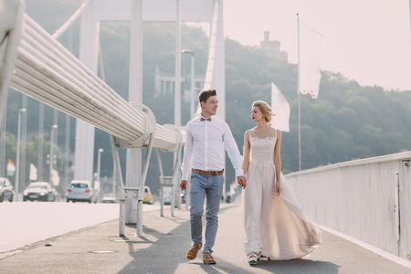 femme romantique: gorgeous wedding couple walking in the old city of Budapest