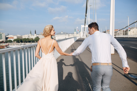 road of love: gorgeous wedding couple walking in the old city of Budapest