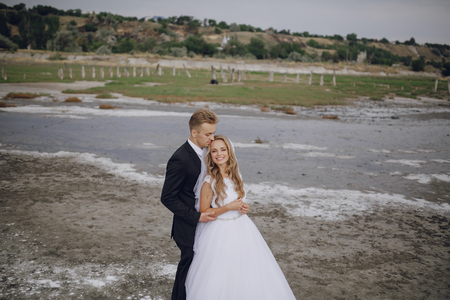 husband and wife: beautiful blonde couple celebrate their wedding day Stock Photo