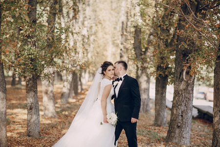 love hug: a wonderful autumn wedding beautiful happy couple