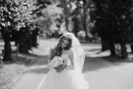 romantic flowers: wonderful wedding curly bride and her handsome husband Stock Photo