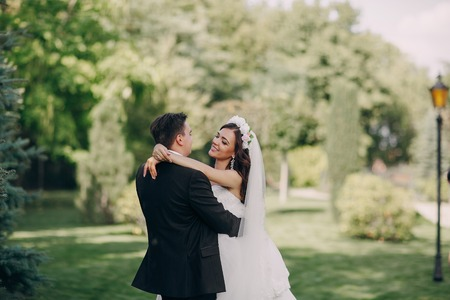 husband and wife: gorgeous wedding and beautiful couple of young people in the summer