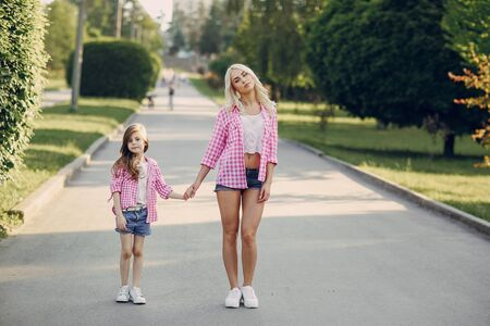 hold hands: mom and daughter walk in the Park shirts