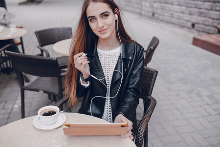 beautiful blue-eyed girl in a cafe with tablet