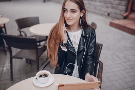 beautiful blue-eyed girl in a cafe with tablet Stock Photo - 66287082