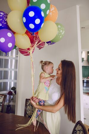 gave: mother welcomed little daughter and gave balls Stock Photo